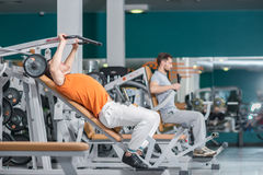 Hello athletes. Hello two athletes at the fitness club. Two beau Royalty Free Stock Photo