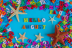 Hello August   Inscription At Blue Summer Background. Summer Month, Beach  And Sea Symbols