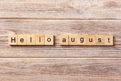 Hello august word written on wood block. hello august text on table, concept Royalty Free Stock Photos
