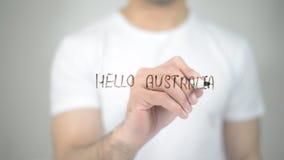 Hello Australia, man writing on transparent screen royalty free stock photo