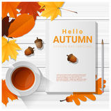 Hello autumn with blank notebook on wooden board background Royalty Free Stock Image