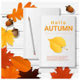 Hello autumn with blank notebooks on wooden board background Royalty Free Stock Photos