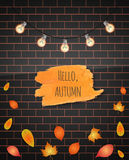 Hello Autumn brush stroke. Vector illustration. Brick wall background. Falling leaves. Garland. Hand drawn. Stock Photos