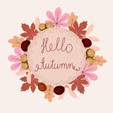 Hello autumn card. Autumn floral frame with leaves, chestnuts, acorns and text hello autumn. Elegant and beautiful card you can use for invitations, scrapbooking Stock Photos