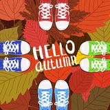 Hello autumn color illustration. Persons feet standing in sneakers on yellow, red, green fallen leaves. Hand drawn royalty free illustration