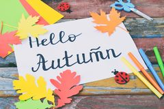 Hello Autumn concept. Making maple leaf from colored paper with your own hands for decoration of greeting card. Handmade crafts. C. Hildren's DIY. Copy royalty free stock photography