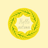 Hello autumn lettering in round frame. Yellow leaves with green veins situated in the shape of a circle and calligraphic inspirational lettering hello autumn Stock Images