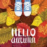 Hello Autumn, Lettering, sneakers, shoes on autumn leaves, autumn leaves, Fall mood, romance, vector, illustration, card. Hello Autumn, Lettering, sneakers Stock Illustration