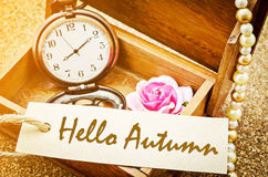 Hello Autumn on paper tag with vintage pocket watch. Royalty Free Stock Photography