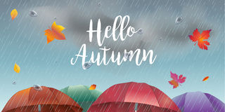 Hello Autumn rainy day. Hello Autumn, rainy day landscape with fall leaves, umbrella, rain, sky with clouds. Rainfall. Autumn Rainy sky, weather, fall season Royalty Free Stock Photos