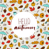 Hello autumn text in round frame on hand drawn fall background with umbrella Royalty Free Stock Photography