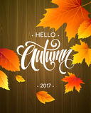 Hello, Autumn. The trend calligraphy. Background of Fall leaves. Concept leaflet, flyer, poster advertising. Vector Royalty Free Stock Photo