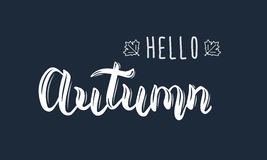 Hello Autumn. Trendy white hand lettering quote, fashion graphics, art print for posters and greeting cards design.  Stock Image
