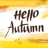 Hello Autumn, vector lettering with abstract background. Royalty Free Stock Photos