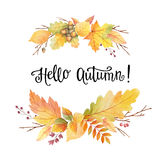 Hello autumn watercolor wreath with colored leaves and hand lettering. Stock Photos