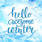 Hello awesome winter. Typography banner with hand lettering, brush script at watercolor frost background. Winter season Stock Image