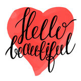 Hello beautiful - calligraphy text on colorful watercolor like heart background. Royalty Free Stock Image