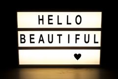 Hello beautiful light box sign board. On wooden table Royalty Free Stock Photo
