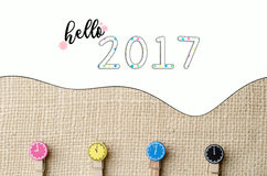 Hello 2017 with colourful wooden clothespins on burlap sack background. Royalty Free Stock Photo