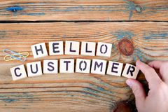 Hello customer. Wooden letters on the office desk Royalty Free Stock Image