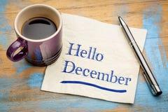 Hello December anmärkning på en servett fotografering för bildbyråer