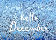 Hello December.Frosty natural pattern on winter window.Frost patterns on glass. Winter ice embroidered lace on the window stock images