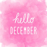 Hello December greeting on abstract pink watercolor background Stock Photos