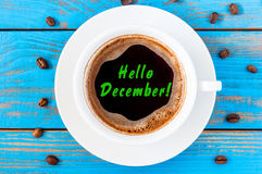 Hello December - inscription at top view morning coffee cup on blue wooden table. Winter, eve, New year concept. Hello December - inscription at top view morning Stock Photos