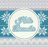 Hello December lettering on knitted winter background   Royalty Free Stock Image