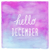 Hello December text on blue and purple watercolor background Royalty Free Stock Image