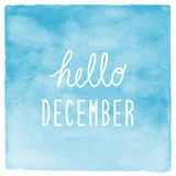 Hello December text with blue watercolor background Stock Photo