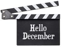 Hello December text on clapboard Royalty Free Stock Images