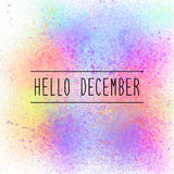 Hello December text on colorful spray paint background Stock Photography