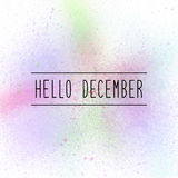 Hello December text on pastel spray paint background Stock Image