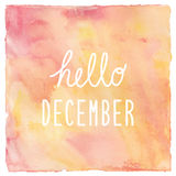 Hello December text on red and yellow watercolor background Royalty Free Stock Images