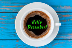 Hello December written on coffee cup at blue wooden desk. Eve, Christmas and New year time concept Stock Photography