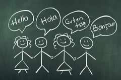 Hello. In different languages on chalkboard stock image