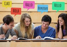 Hello in different languages chat bubbles learning with students. Digital composite of Hello in different languages chat bubbles learning with students Stock Image