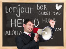 Hello in different languages. Woman near words hello in different languages on chalkboard royalty free stock photo