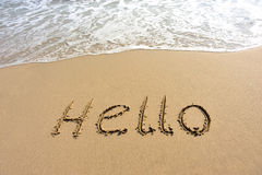 Hello drawn on the beach Royalty Free Stock Photos