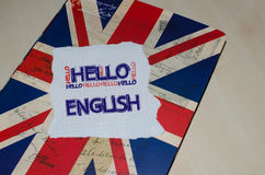 Hello English written on piece of paper Royalty Free Stock Photos