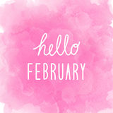 Hello February greeting on abstract pink watercolor background Stock Image