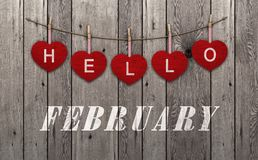 Free Hello February Written On Hanging Red Hearts And Old Wooden Background Royalty Free Stock Photo - 108606445