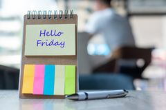 Hello Friday text on note paper or empty reminder template on wooden table. New Goal New Start concept. Hello Friday text on note paper or empty reminder stock photos