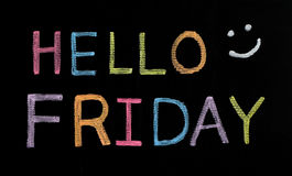 Hello Friday written on blackboard Stock Images