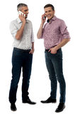 Hello friend, How are you?. Full length of handsome men talking on cell phone royalty free stock photos
