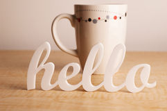 Hello in Front of Coffee Mug Royalty Free Stock Photography