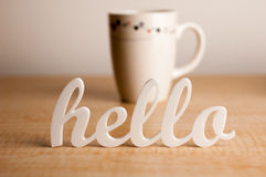 Hello in Front of Coffee Mug Royalty Free Stock Photo