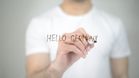 Hello Germany, man writing on transparent screen. High quality stock photography