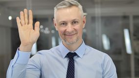 Hello, Grey Hair Businessman Waving Hand to Welcome stock video